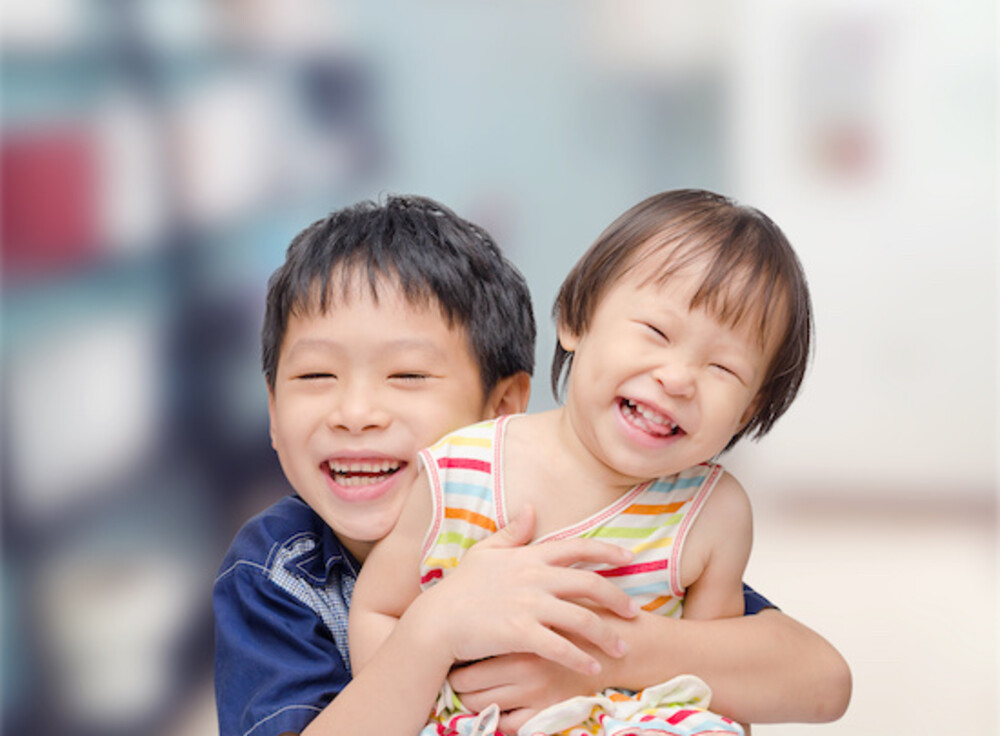 Photo of two chinese siblings smiling